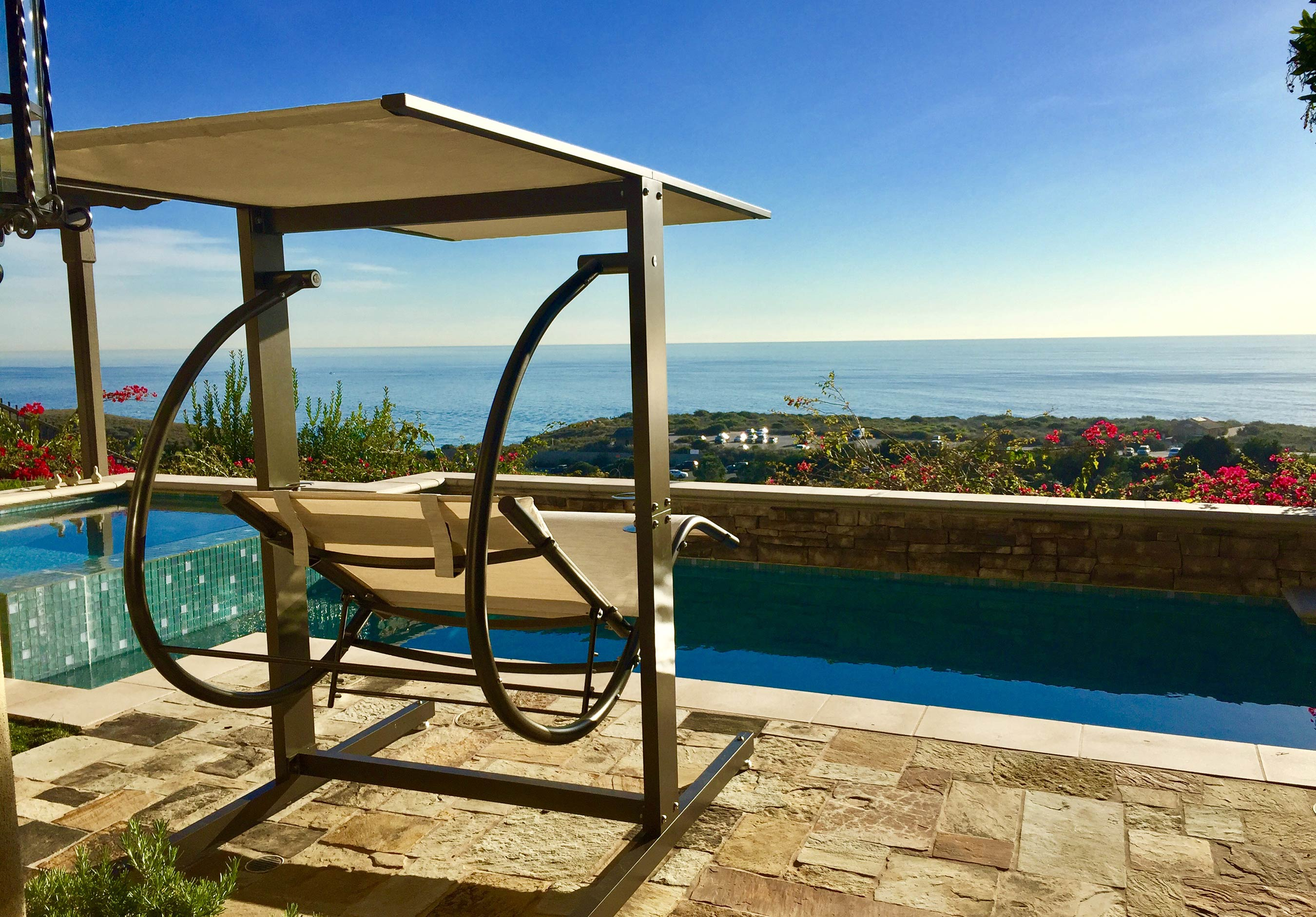 David Frank Furniture: Luxury Swing Company - Brown Swing with White Fabric by pool overlooking ocean